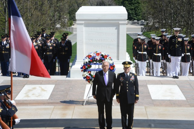 Jorge Burgos, Minister of National Defense, Republic of Chile stands with Maj. Gen. Jeffrey S. Buchanan, Joint Force Headquarters-National Capital Region/U.S. Army Military District of Washington commanding general, during an Armed Forces Full Honors Wreath Laying ceremony at the Tomb of the Unknown Soldier in Arlington National Cemetery, Va., April 16, 2014.