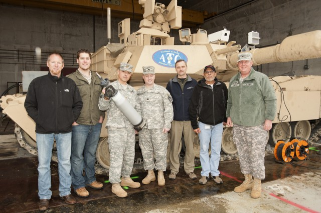 A new tank cartridge was recently tested at Aberdeen Proving Ground, Md. Pictured here are: (from left) Kent Evans, TRADOC Capability Manager - Armored Brigade Combat Team; Kevin Mulligan, Armament Research, Development and Engineering Command; Maj. Juan Santiago, assistant product manager; Lt. Col. Brian Gruchacz Product Manager; Greg Malejko, ARDEC; Steve Peralta, is Mounted Requirements Division, Maneuver Center of Excellence; and Col. Rocky Kmiecik, director, Mounted Requirements Division, Maneuver Center of Excellence.