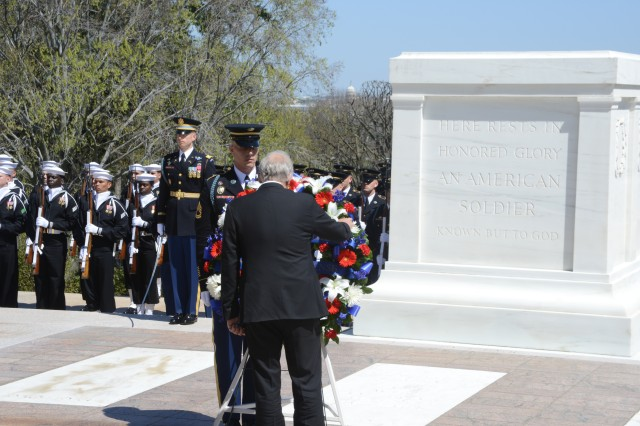 Jorge Burgos, Minister of National Defense, Republic of Chile lays a wreath at the Tomb of the Unknown Soldier during an Armed Forces Full Honors Wreath Laying ceremony in Arlington National Cemetery, Va., April 16, 2014.