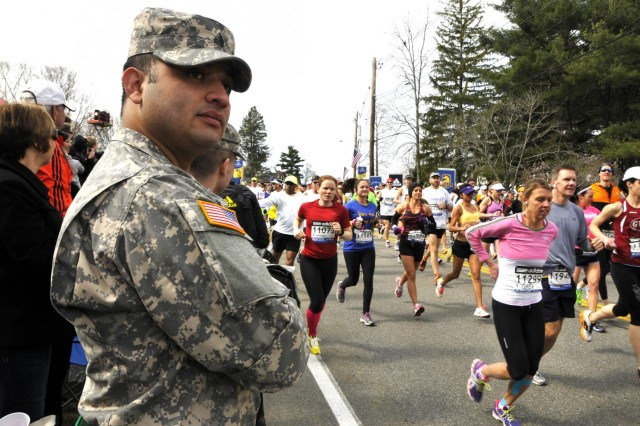 Sgt. Ezequiel Valencia, a human resources sergeant, with the 747th Military Police Company, Massachusetts Army National Guard, looks on as runners begin the 117th Boston Marathon April 15, 2013, in Hopkinton, Mass. April 15 marked the one-year anniversary of last year's Boston Marathon bombing, which left three people dead and more than 260 injured.