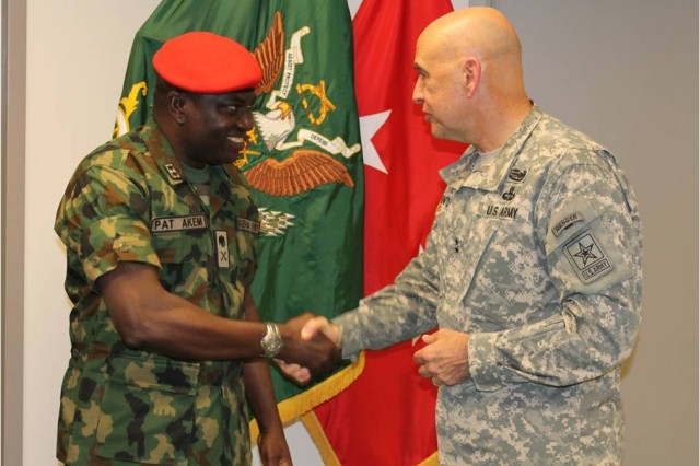 MG David Quantock, Provost Marshal General thanking MG Pat Akem, Provost Marshal of the Nigerian Army for his partnership to  the Senior Leader Conference on Detainee Operations during April 2014