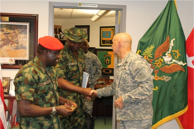 Pictured from the left: MG Pat Akem, the Nigerian Provost Marshal General, and his MP Commandant, LTC Eberulu, MG Quantock, Provost Marshal General.  PMG6  thanks the Nigerian Provost Marshal Officers for partnership during a Senior Leaders Conference on Detainee Operations  on 14 April 2014.