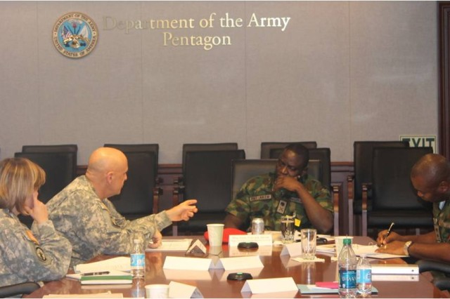 Pictured from the left:  LTC(P) Eugenia Guilmartin, MG David Quantock, Provost Marshal General, COL  MG Pat Akem, Provost Marshal of the Nigerian Army, LTC Eberulu, MP Camp Commandant for engagements , and COL(Retired) Donald Hall, former Deputy Commander for Administration for the 31st Combat Support Hospital at Camp Bucca, Iraq discuss Detainee Operations during a Senior Leaders Conference on 14 April 2014