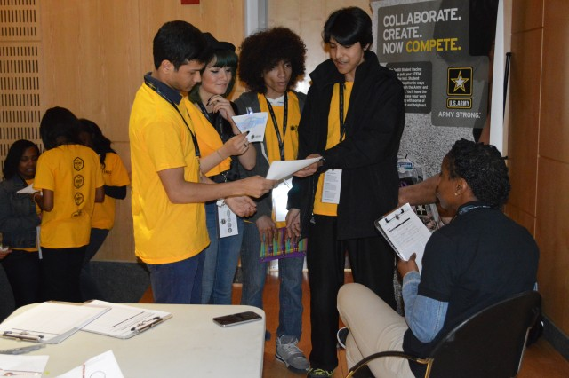 One foursome of high school students builds up their courage to pitch the judge with their motorsports company winning pitch before time runs out.  Each student played a role on the team during this U.S. Army Racing Challenge and National STEM League competition April 11, 2014, sponsored by the U.S. Army and Ten80 Education hosted at Medgar Evers College in Brooklyn, N.Y. Technology is advancing at a rate never before seen in our history. Every day, science fiction moves closer to becoming science fact. Some understanding of science, technology, engineering and mathematics will be an essential element of these students' future success.