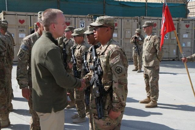 The Under Secretary of the U.S. Army Brad R. Carson, congratulates Spc. John P. Guingao on his receipt of the Combat Action Badge during an awards ceremony at Forward Operating Base Fenty, Afghanistan on April 17, 2014.  (U.S. Army photo by CJTF-10 and Regional Command-East Public Affairs)