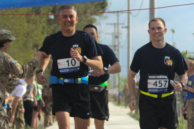 Combined Joint Task Force-10 Commander Maj. Gen. Stephen Townsend, Aide-to-Camp Capt. Jayson Williams, and Protective Services Officer Sgt. 1st Class Michael Duque, finish the Boston Marathon Shadow Run together at Bagram Air Field, Afghanistan, April 18, 2014. More than 500 service members and civilians deployed to Afghanistan competed in this year's marathon. The Shadow Run is the only sanctioned Boston Marathon overseas.