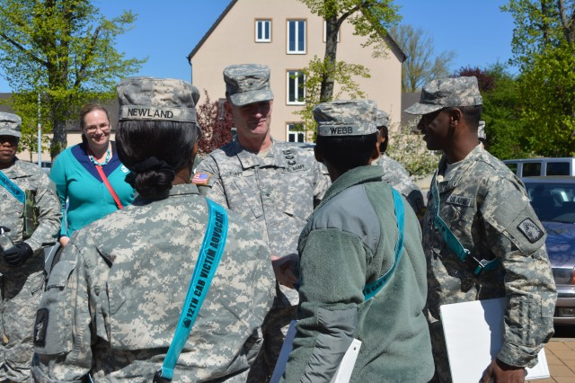 "Brig. Gen. Walter E. Piatt, commander of the 7th U.S. Army's Joint Multinational Training Command, meets with U.S. Army Garrison Ansbach victim advocates before a ""Walk to End Violence."" Because April is Sexual Assault Awareness Month, USAG Ansbach's Sexual Harassment and Assault Response and Prevention, or SHARP, team sponsored a ""Walk to End Violence"" April 17, 2014, at Katterbach Kaserne, Germany."