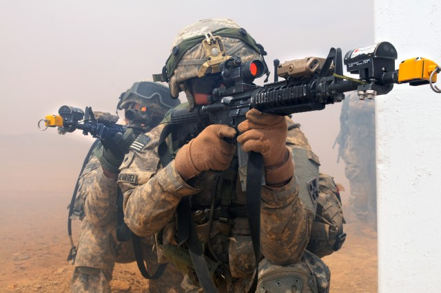Spc. Carlos Murillo-Alvarez (right) and Sgt. Donovan Turner, both infantryman assigned to Company A, 1st Battalion, 67th Armor Regiment, 2nd Armored Brigade Combat Team, 4th Infantry Division, pull guard while their fellow Soldiers assault an objective during the culminating event for Friendship and Ironhawk 3, a two-week military-to-military exercise at the Tactical Training Center, Tabuk, Saudi Arabia, April 14, 2014. Soldiers of 1st Bn., 67th Armor Reg., and the Royal Saudi Land Forces worked together to successfully conduct a mixture of counter insurgency and full-spectrum combat training with the end result of strengthening stability and improving interoperability between the two nations.