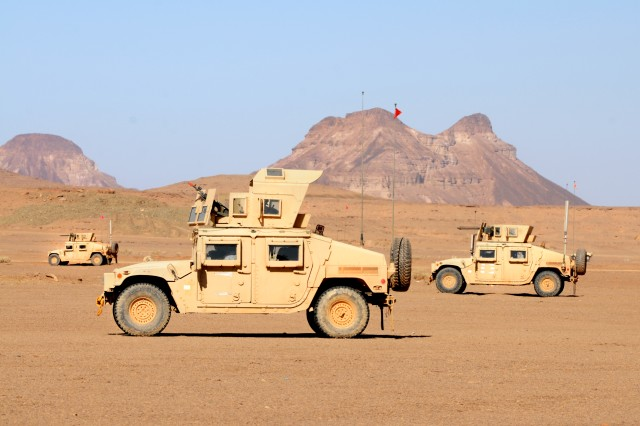 Three Humvees assigned to 1st Battalion, 67th Armor Regiment, 2nd Armored Brigade Combat Team, 4th Infantry Division, pause prior to assaulting an objective during Friendship and Ironhawk 3, a two-week military-to-military exercise between U.S. and Saudi Arabian forces at the Tactical Training Center, Tabuk, Saudi Arabia, April 13, 2014. The two countries conducted planning at the battalion and brigade levels, which allowed the platoon and company levels an opportunity to share tactics, techniques and procedures.