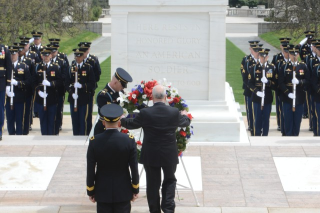 The Honorable Terrance W. Gainer, sergeant-at-arms of the United States Senate, lays a wreath at the Tomb of the Unknown Soldier during an Army Full Honors Wreath Laying Ceremony in Arlington National Cemetery, April 18, 2014.