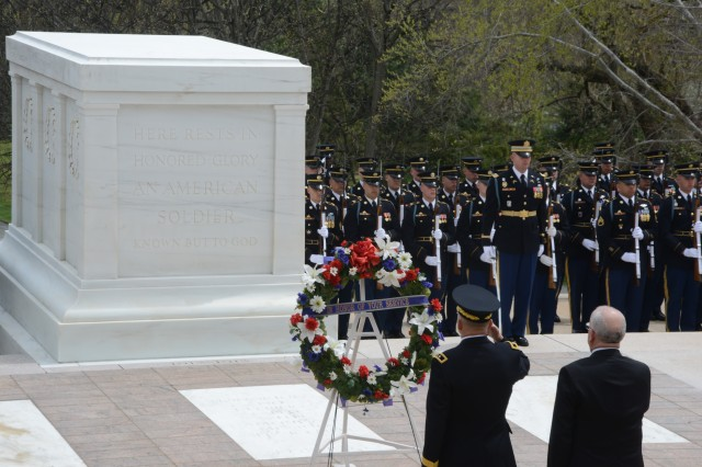 The Honorable Terrance W. Gainer, sergeant-at-arms of the United States Senate (right), and Maj. Gen. Jeffrey S. Buchanan (left), Joint Force Headquarters-National Capital Region and the U.S. Army Military District of Washington commanding general render honors during an Army Full Honors Wreath Laying Ceremony at the Tomb of the Unknown Soldier in Arlington National Cemetery, April 18, 2014.
