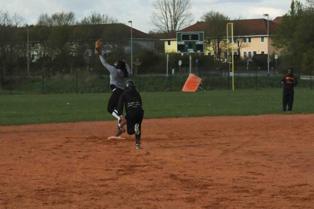ROSE BARRACKS, Germany -- Brittany C. Watkins, a senior at Vilseck High School, catches a ball to tag out a runner during softball practice on April 16, 2014.  Watkins also accepted a scholarship offer and signed a formal letter of intent to play softball for the University of Charleston, W. Va.