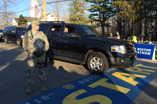 Airman 1st Class Eric Lapworth, Security Forces, 102nd Intelligence Wing, Massachusetts Air National Guard, provides traffic control for law enforcement agencies at the start of the 118th Boston Marathon in Hopkinton, Mass., April 21, 2014.