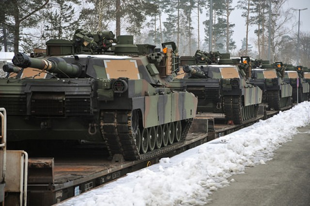 U.S. Army M1A2 Abrams tanks arrive at the Grafenwoehr Training Area, Germany, Jan 31, 2014. The vehicles are part of the European Activity Set, a combined-arms battalion-sized set of vehicles and equipment pre-positioned at the Grafenwoehr Training Area designed to support the U.S. Army's European Rotational Force and the NATO Response Force during training exercises and real-world missions.  The tanks will be used for the first time in May during exercise Combined Resolve II at the U.S. Army's Grafenwoehr and Hohenfels Training Areas.