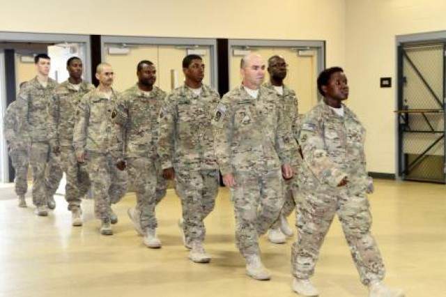 Soldiers assigned to the 497th Movement Control Team, 203rd Brigade Support Battalion, 3rd Armored Brigade Combat Team, 3rd Infantry Division march into Freedom Hall during their welcome home ceremony at Lawson Army Airfield April 18. The 497th MCT deployed to Afghanistan, July 2014, in support of the largest retrograde operation in U.S. Army history, said 203rd BSB Commander Lt. Colonel Brent D. Coryell.