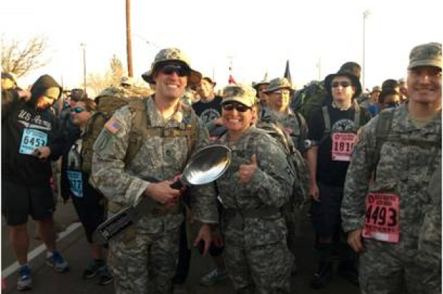 Sgt. 1st Class Nick James, of Akron, Ohio, chief of electronics maintenance at U.S. Army Special Operations Command, and Sgt. 1st Class Evelyn Barajas, of Barstow, Calif., the 402nd Field Artillery Brigade's intelligence operations non-commissioned officer, pose with the big spoon at the start of the Bataan Memorial Death March at White Sands Missile Range, N.M. March 23.
