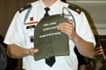 Sgt. Timothy Gilboe receives back his life-saving body armor