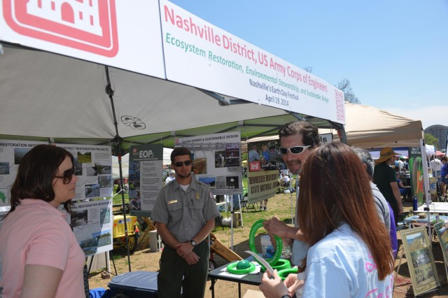 Mary Lewis, biologist, Customer Outreach and Silver Jackets coordinator for the U.S. Army Corps of Engineers, Nashville District, (Left) and Ben MacIntyre, a park ranger from J. Percy Priest Lake Resource Center (right) talk with a couple as they stopped at the Nashville District booth during the 13th annual Nashville Earth Day Festival at Centennial Park April 19. The event featured exhibits and activities aimed at educating everyone about protecting our environment. The environmental friendly festival drew environmentalists of all ages to hundreds of family-friendly eco booths, hosted by government agencies, environmental organizations, and community groups who provided T-shirts, cups, pencils and goodies for all ages.