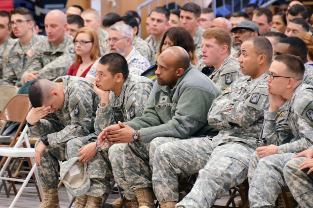 """A solemn mood falls over the audience at Katterbach Fitness Center as Soldiers listen to Bernie McGrenahan's story about his younger brother's drug- and alcohol-related suicide, and the impact it had on the lives of him and his family. McGrenahan visited Katterbach Kaserne and Storck Barracks April 17, 2014, as part of his international """"Happy Hour"""" Comedy with a Message Tour. His visit to U.S. Army Garrison Ansbach was sponsored by the USAG Ansbach Army Substance Abuse Program. McGrenahan's show featured comedy on a variety of subjects, as well as serious subject matter on the negative consequences of alcohol and drug use."""