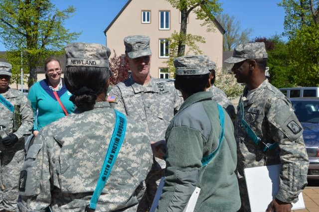 "U.S. Army Garrison AnsbachBrig. Gen. Walter E. Piatt, commander of the 7th U.S. Army's Joint Multinational Training Command, meets with U.S. Army Garrison Ansbach victim advocates before a ""Walk to End Violence."" Because April is Sexual Assault Awareness Month, USAG Ansbach's Sexual Harassment and Assault Response and Prevention, or SHARP, team sponsored a ""Walk to End Violence"" April 17, 2014, at Katterbach Kaserne, Germany."