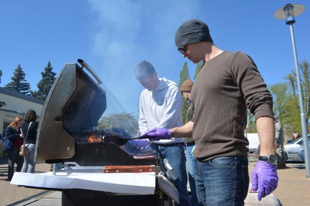 "Chief Warrant Officer 2 Joseph Shaughnessy grills up burgers in support of the ""Walk to End Violence."" Because April is Sexual Assault Awareness Month, U.S. Army Garrison Ansbach's Sexual Harassment and Assault Response and Prevention, or SHARP, team sponsored a ""Walk to End Violence"" April 17, 2014, at Katterbach Kasernem, Germany."