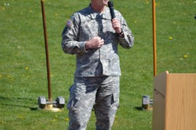 "Brig. Gen. Walter E. Piatt, commander of the 7th U.S. Army's Joint Multinational Training Command, speaks at an assembly during a ""Walk to End Violence"" at the Ansbach Middle / High School track. Because April is Sexual Assault Awareness Month, U.S. Army Garrison Ansbach's Sexual Harassment and Assault Response and Prevention, or SHARP, team sponsored a ""Walk to End Violence"" April 17, 2014, at Katterbach Kaserne, Germany."