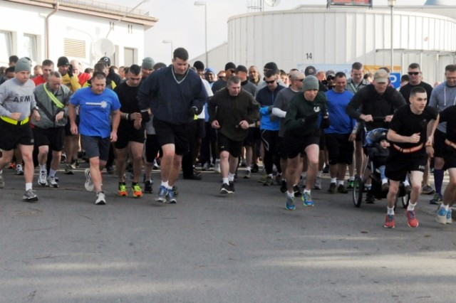 Hundreds of runners take part in a Sexual Assault Awareness Month 5K run at Hohenfels, April 16.