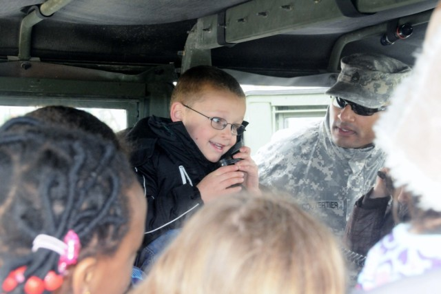 Aaron Hagelin practices his radio skills during Job Shadow Day at Hohenfels Elementary School, recently.