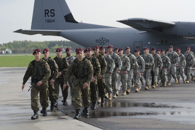 Paratroopers from U.S. Army Europe's 173rd Airborne Brigadearrive at Swidwin Air Base, Poland, April 23, 2014, to begin a training rotation with the Polish army's 6th Airborne Brigade, one of the brigade's sister units. The Soldiers are here with their NATO allies in Poland, Estonia, Latvia and Lithuania as part of recently announced exercises to demonstrate U.S. commitment to the alliance and increase interoperability between forces.