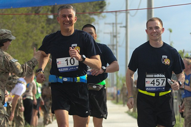 Maj. Gen. Stephen J. Townsend, Combined Joint Task Force-10 and 10th Mountain Division (LI) commander; Capt. Jayson Williams, aide-de-camp; and Sgt. 1st Class Michael Duque, protective services officer, finish the Boston Marathon Shadow Run together at Bagram Airfield, Afghanistan, on Friday.