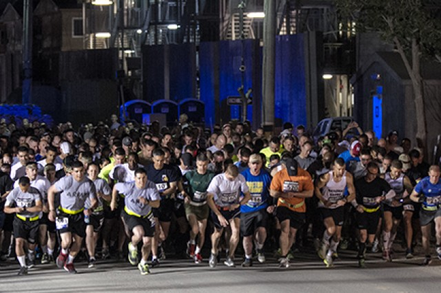 """Hundreds of runners take off during the Boston Marathon """"Shadow Run"""" at Bagram Airfield, Afghanistan, on Friday. More than 500 service members and civilians deployed to Afghanistan competed in the only sanctioned Boston Marathon overseas."""