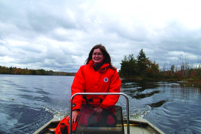 Fish and Wildlife Management Branch biologist Laura Cowger operates a boat on Indian Lake. Cowger serves as an aquatics specialist.