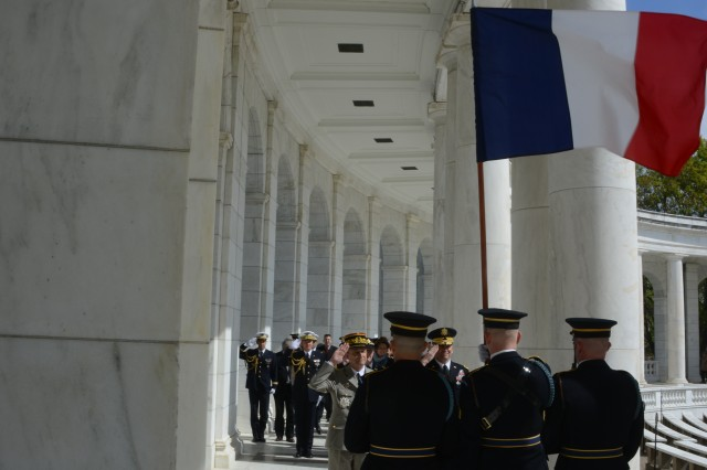General Pierre De Villiers, Chief of Defense, France and Maj. Gen. Jeffrey S. Buchanan, Joint Force Headquarters-National Capital Region/U.S. Army Military District of Washington commanding general, render honors to the French flag following an Armed Forces Full Honors Wreath Laying ceremony at the Tomb of the Unknown Soldier in Arlington National Cemetery, April 23, 2014.