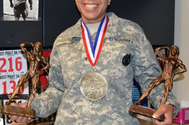 "Staff Sgt. Michelle Larrieux poses with bodybuilding awards which she keeps at her work space at the Harker Heights Recruiting Center. ""A lot of applicants that I see are interested in what I do and it motivates them,"" Larrieux said."