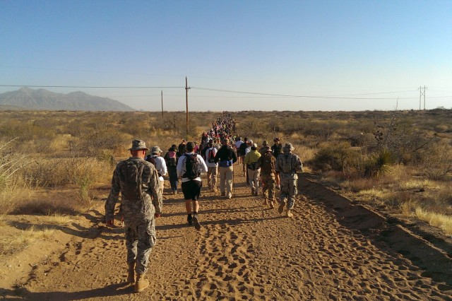 Army medical recruiters from Overland park, Kan., take part in the annual Bataan Memorial Death March, March 22.
