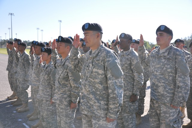Soldiers with the 1st Battalion, 34th Infantry Regiment take the oath of allegiance April 16, 2014, at Hilton Field, Fort Jackson, S.C.