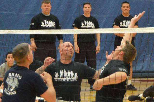 Soldiers from Company A, Warrior Transition Battalion, battle Soldiers from Company B during a sitting volleyball game, April 16, 2014, at Fort Carson, Colo. Company A was the overall winner of the two-day Warrior Transition Battalion Commander's Stakes competition.