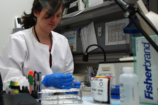 Crystal Breedlove, MACH blood bank supervisor, works on a laboratory sample in the hospital lab.