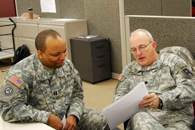 COLUMBUS, Ohio (April 24, 2014) -- Chap. (Lt. Col.) Joel Russell, a First Army observer coach/trainer, demonstrates one-on-one coaching and 'hip-pocket' training for chaplains to Chap. (Capt.) Otis Thomas (37th Infantry Brigade) during a command post exercise for the 16th Engineer Brigade conducted in Columbus, Ohio, last month. First Army provided scenario design expertise, exercise control and observer controller/trainer support to the exercise, which prepared the engineers to participate in a major Warfighter exercise with the 82nd Airborne Division.