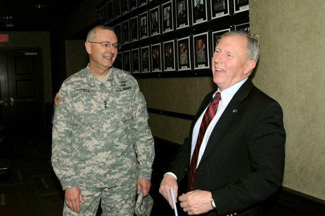 ROCK ISLAND ARSENAL, Ill. -- Lt. Gen. Michael S. Tucker, First Army commanding general, shares a laugh with retired Maj. Gen. J.B. Burns, former Forces Command deputy commanding general, during a tour of First Army headquarters on Wednesday. (First Army photo by Wayne Marlow)