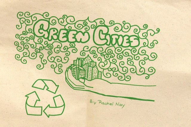 "Rachel Nay, a sixth-grader, won this year's Earth Day art competition, with her drawing of ""Green Cities."" Nay was presented with a T-shirt and a shopping tote bag which depicted her drawing during Arnn Elementary's ""Earth Day Celebration"" event, held on April 23 inside the school cafeteria."