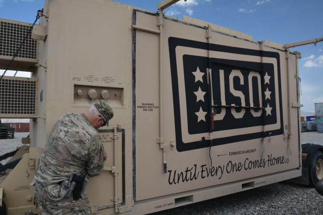 A USO mobile stage awaiting disposition is parked in one of the yards belonging to Logistics Task Force Bagram.  Maj. Charles V. Martin, LTF Bagram officer-in-charge, said this is one of the more unusual items he has seen turned in to the Redistribution Property Assistance Team yard.