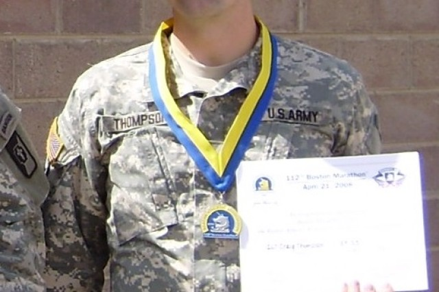 Capt. Craig Thompson in Iraq in2008 after completing his first Boston Marathon. Thompson ran the marathon in person on April 21, 2014, in 3 hours, 14 minutes, 59 seconds, achieving a personal goal he set for himself.