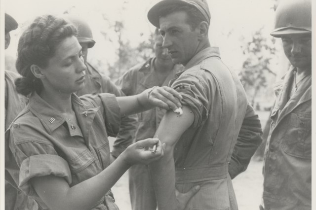 24th Portable Hospital nurse injects troops