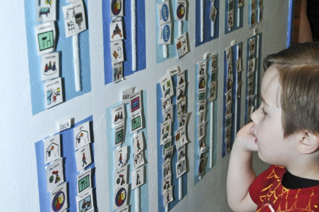 COLOROADO SPRINGS, Colo. -- Tristram Waller looks at his picture schedule during an applied behavioral analysis appointment at the Colorado Autism Center, April 10. The pictures help him know what activity he is supposed to do next and have been proven to help children with Autism Spectrum Disorder. Tristram was diagnosed in July with Autism Spectrum Disorder and receives four hours of treatment three times per week.