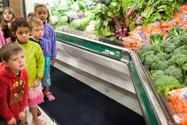 Children from Cody Child Development Center's Robins B class of 4 to 5 year-olds look at vegetables in Joint Base Myer-Henderson Hall's commissary April 22, 2014. The children toured the commissary as a part of Earth Day activities.