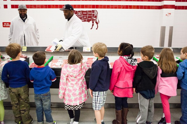 Damian Lofton, work leader, shows children from Cody Child Development Center's Robins B class of 4-to 5-year-olds packaged ground beef during a tour of Joint Base Myer-Henderson Hall's commissary April 22, 2014. The children toured the commissary as a part of Earth Day activities.