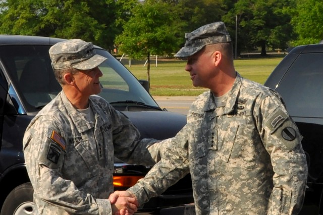 Gen. Daniel B. Allyn, commanding general, U.S. Army Forces Command, greets Gen. David G. Perkins, commanding general, U.S. Army Training and Doctrine Command, as Perkins arrives at FORSCOM's Marshall Hall headquarters at Fort Bragg, N.C., April 25, 2014. Perkins and Allen met to discuss and synchronize efforts in support of the U.S. Army Chief of Staff's vision and goals.