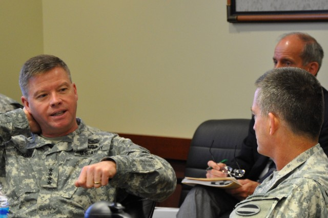 (L-R) Gen. David G. Perkins, commanding general, U.S. Army Training and Doctrine Command, makes a point during an April 25, 2014 discussion with Gen. Daniel B. Allyn, commanding general, U.S. Army Forces Command (FORSCOM) about the two Army command's work towards the U.S. Army Chief of Staff's vision and goals.  The two senior leaders met at FORSCOM's Marshall Hall headquarters at Fort Bragg, N.C. (U.S. Army photo by Jim Hinnant, FORSCOM Public Affairs)