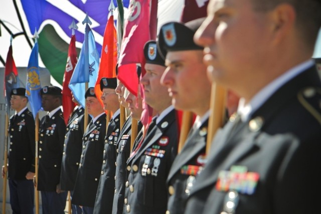 Soldiers with the 4th Brigade Combat Team, 101st Airborne Division (Air Assault), stand with guidons from their respective companies, March 13, 2014, during the brigade's final Distinguished and Honorary Member of the Regiment Ceremony at Fort Campbell, Ky.